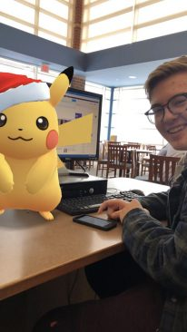 Riley Soltis and his Festive Pikachu in the Library ! Pika Pika !