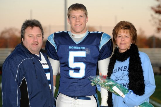AJ Holderman with Mike and Lisa Holderman (parents)