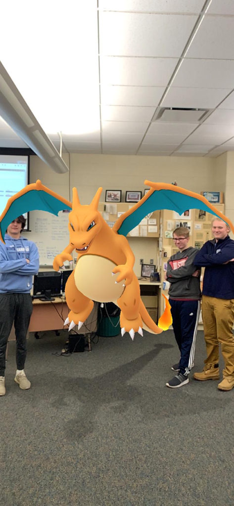 Colin, Max and the slime snag a picture with Charizard.