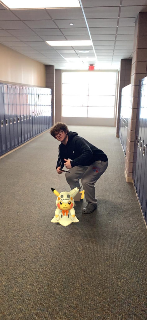 Vandy posting up in the hallways with Pikachu in his Mimikyu costume