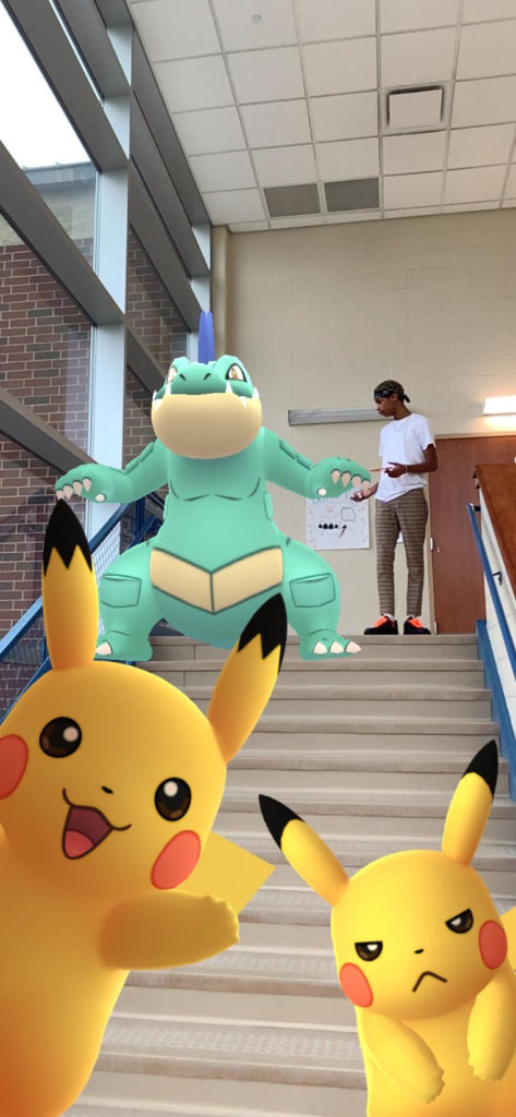 Malcolm puzzled by all the pokemon in the stairwell!