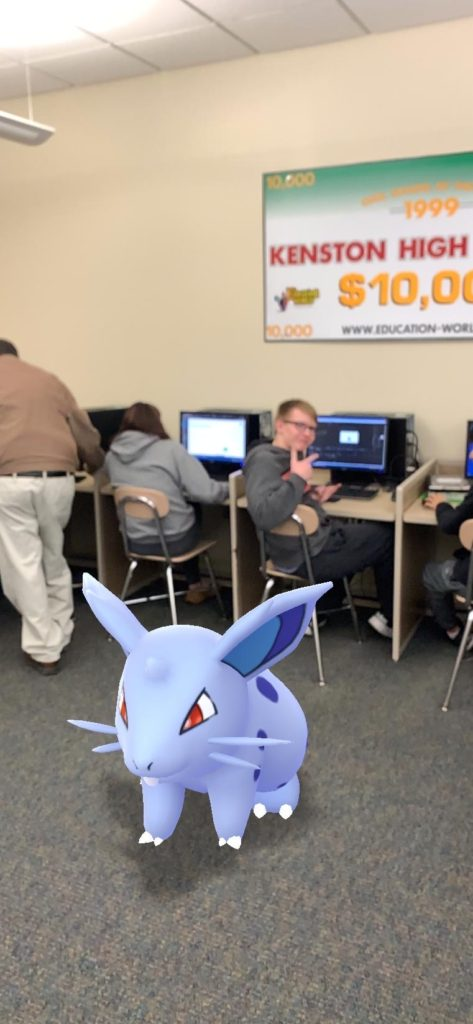 Sam and Nidoran taking time out of class to hang with Mr. C