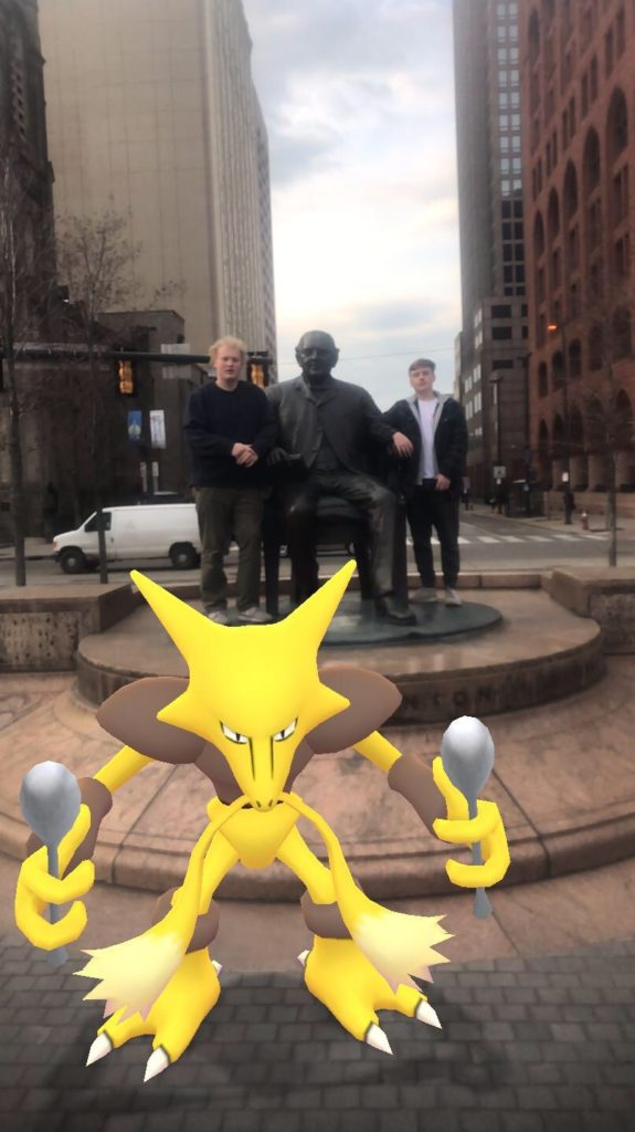 Max and Riley taking a stroll downtown Cleveland with a wild Alakazam