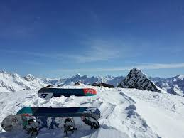 snowboards at the top of a snowy mountain